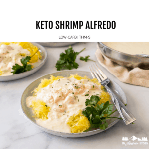 keto shrimp alfredo with spaghetti squash on gray plate