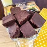 Try this easy condensed milk fudge recipe for an easy, healthy chocolate dessert. This 2 ingredient low carb fudge is sugar free, which means it will soon become one of your favorite THM dessert recipes. This holiday microwave fudge recipe will have everyone who tries it amazed! #ketofudge #thmdessertrecipe #microwavefudge #sugarfreefudge