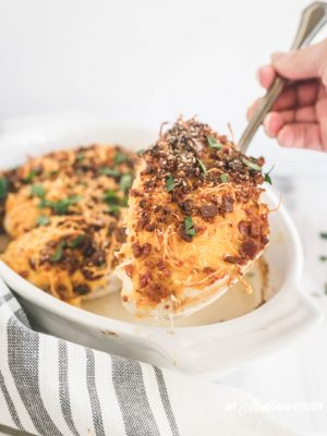This easy chicken with bacon and cheese couldn't be any easier! Juicy and tender chicken smothered in melty cheese and crispy bacon. This is a recipe that comes together in 5 minutes, and it makes a great weeknight dinner recipe! #cheesybaconchicken #lowcarbchickenrecipe