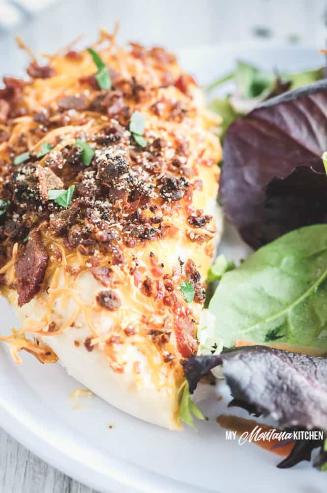 With only 5 minutes of hands on prep time (or less), this Low Carb Bacon Cheese Chicken Recipe makes an easy and delicious weeknight dinner. A healthy recipe that everyone in your family will love! #lowcarbchickendinner #baconcheesechicken