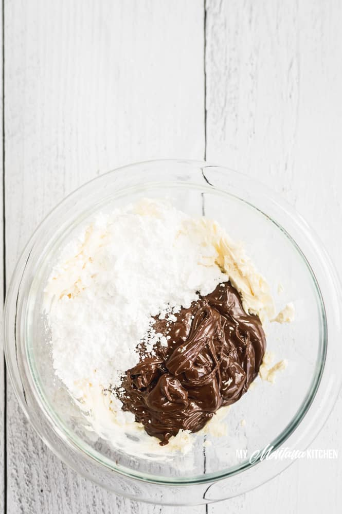 These easy keto chocolate truffles with cream cheese are sugar free, and flavored with a swirl of rich coffee, making them a decadent low carb dark chocolate dessert recipe! #ketotruffles #lowcarbchocolatedessert