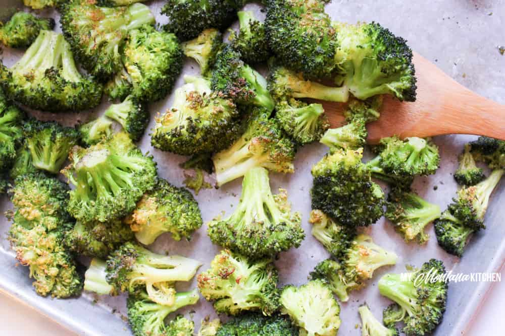 A quick and easy side dish, this Oven Roasted Broccoli Recipe only uses a handful of ingredients, but is delicious enough to become your new favorite low carb side dish! #roastedbroccoli #broccolirecipe