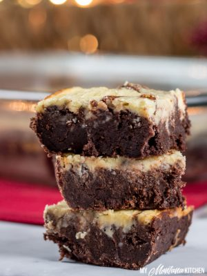 Dense, fudgy brownies topped with a creamy layer of peppermint cheesecake. This is the perfect marriage of chocolate and peppermint for a low carb, keto chocolate Christmas dessert. Works great as a Trim Healthy Mama S Dessert Recipe, too! #lowcarb #keto #thm #trimhealthymama #healthybrownie #ketobrownie #lowcarbbrownie #sugarfree #glutenfree #chocolatepeppermint #peppermintcheesecakebrownies #peppermint