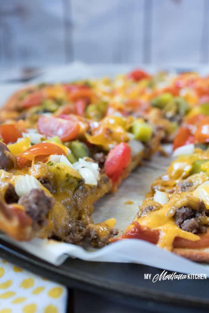 An easy low carb pizza dough makes this Cheeseburger Pizza an easy dinner idea for your family! #trimhealthymama #thm #lowcarb #keto #cheeseburger #pizza #groundbeef #easyrecipe #glutenfree