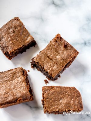 Rich, decadent, fudgy Chocolate Peanut Butter Brownies that can be made in less than 30 minutes! These low carb brownies make an excellent keto dessert, and they are sugar free and gluten free as well! Chocolate Peanut Butter Brownies will be a new favorite healthy dessert recipe! #trimhealthymama #thm #thms #lowcarb #keto #glutenfree #dairyfree #sugarfree #peanutbutterbrownies #chocolatepeanutbutter