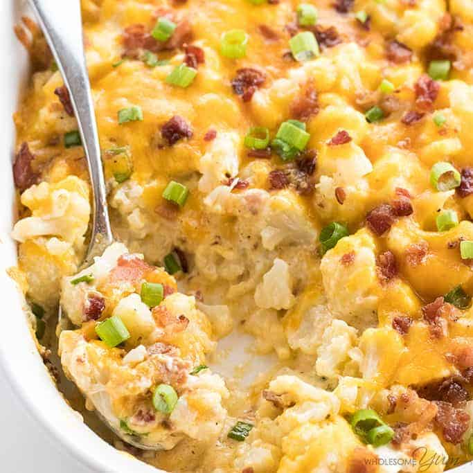 This cheesy loaded cauliflower casserole recipe needs just 10 minutes prep. All the flavors of a loaded baked potato, without the carbs. Easy & delicious!