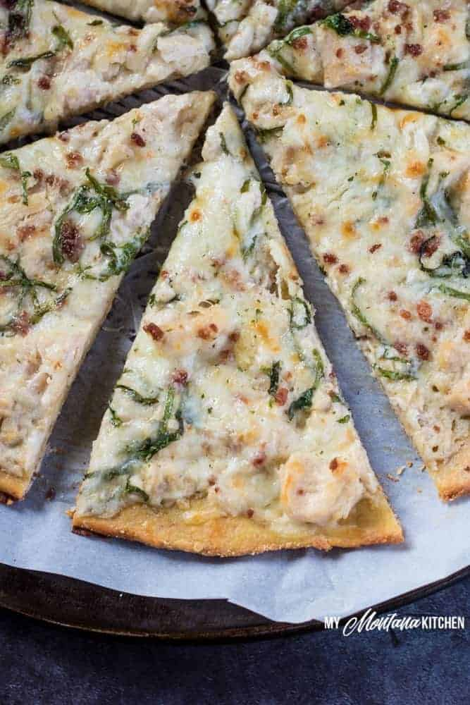 This low carb Chicken Alfredo Pizza recipe is a satisfying (and delicious!) gluten free pizza that you're going to want to make again and again. Just because you're eating low carb, doesn't mean you have to sacrifice your favorite foods. This low carb Chicken Alfredo Pizza recipe is proof of that! With the perfect low carb crust and creamy parmesan garlic sauce, this Chicken Alfredo Pizza makes a great low carb family dinner! #pizza #lowcarbpizza #ketopizza #alfredo #alfredopizza #lowcarb #keto #glutenfree #trimhealthymama #thms #thmpizzarecipe #familydinnerrecipe