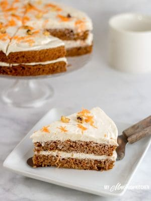 A dense sugar free carrot cake filled with cinnamon, walnuts, and carrots. Topped with a luscious cinnamon cream cheese frosting, you have a low carb carrot cake that everyone can enjoy! #lowcarbcarrotcake #ketocarrotcake