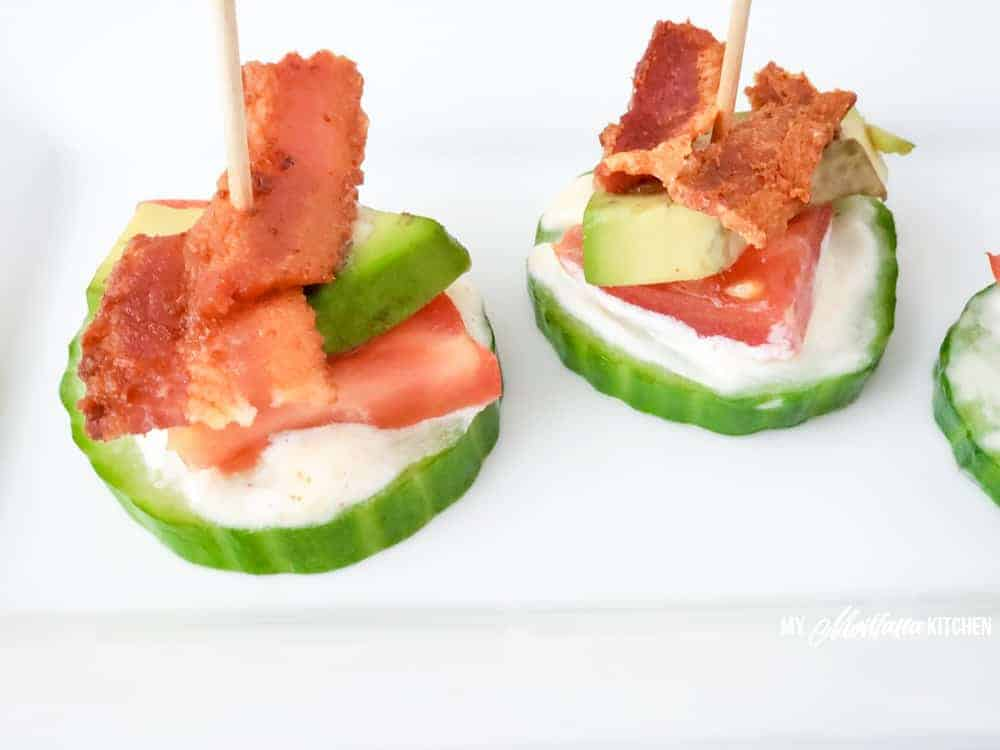 close up photo of blt bites with cucumber, spicy mayo, tomato, avocado, and bacon