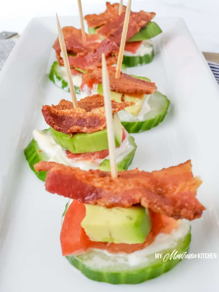 keto blt bites with toothpicks on long white plate