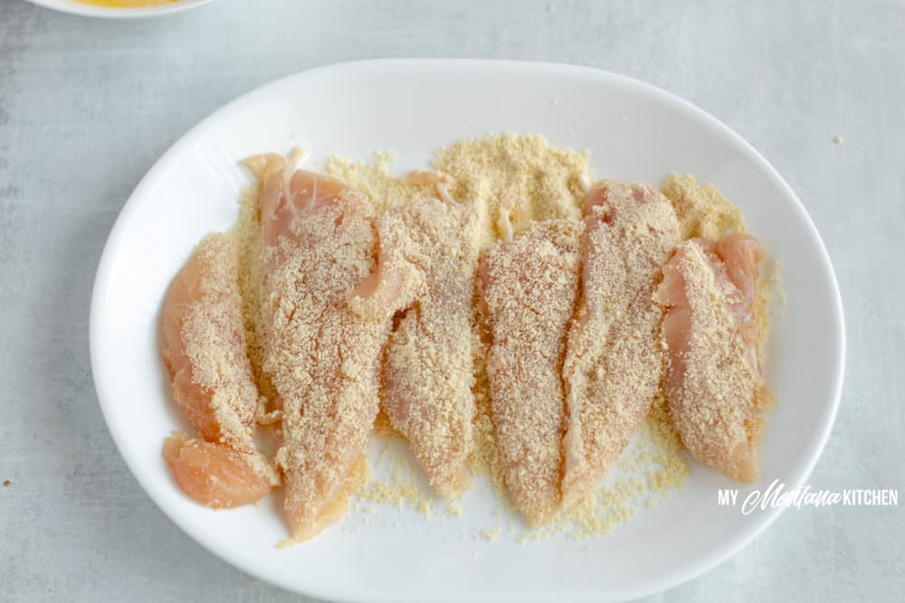 raw chicken tenders with almond flour breading