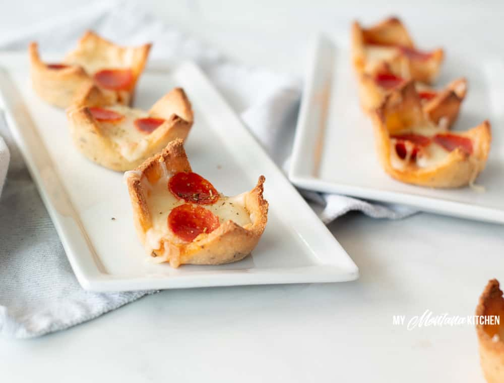 pizza cups on white rectangle tray