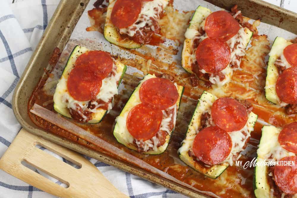baked pizza zucchini boats on baking sheet