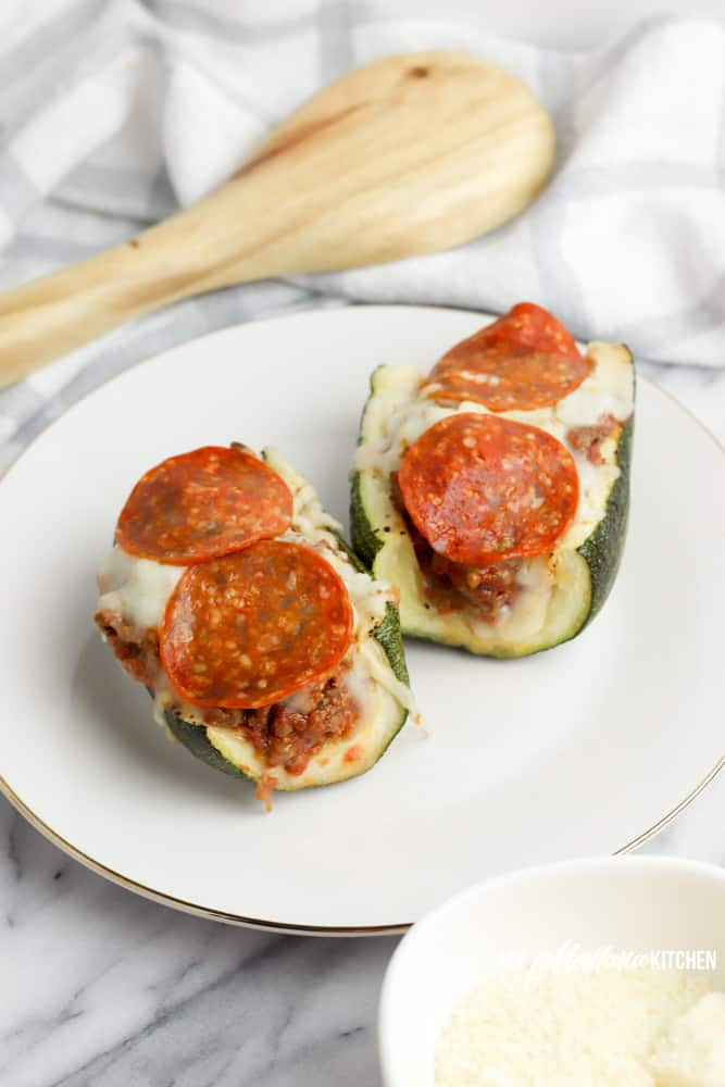 pizza zucchini boats on white plate