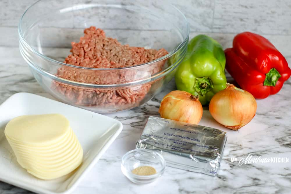 ingredients for philly cheesesteak casserole burger peppers onions cheese cream cheese garlic powder