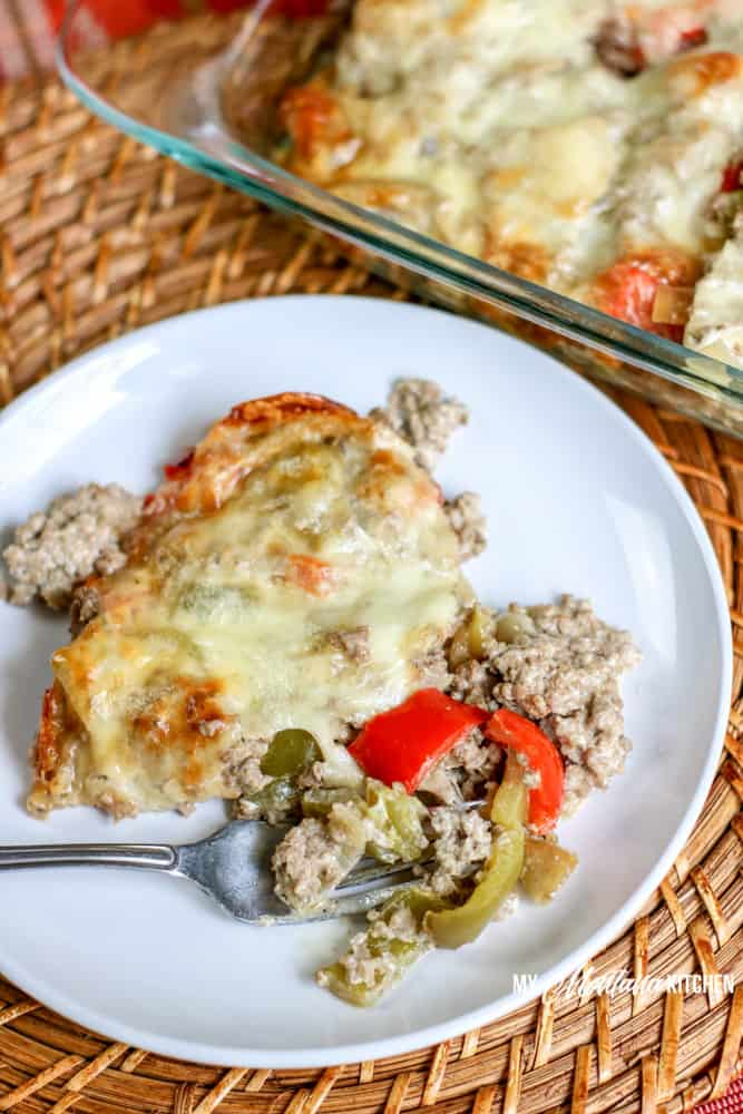 low carb philly cheesesteak casserole on white plate with fork