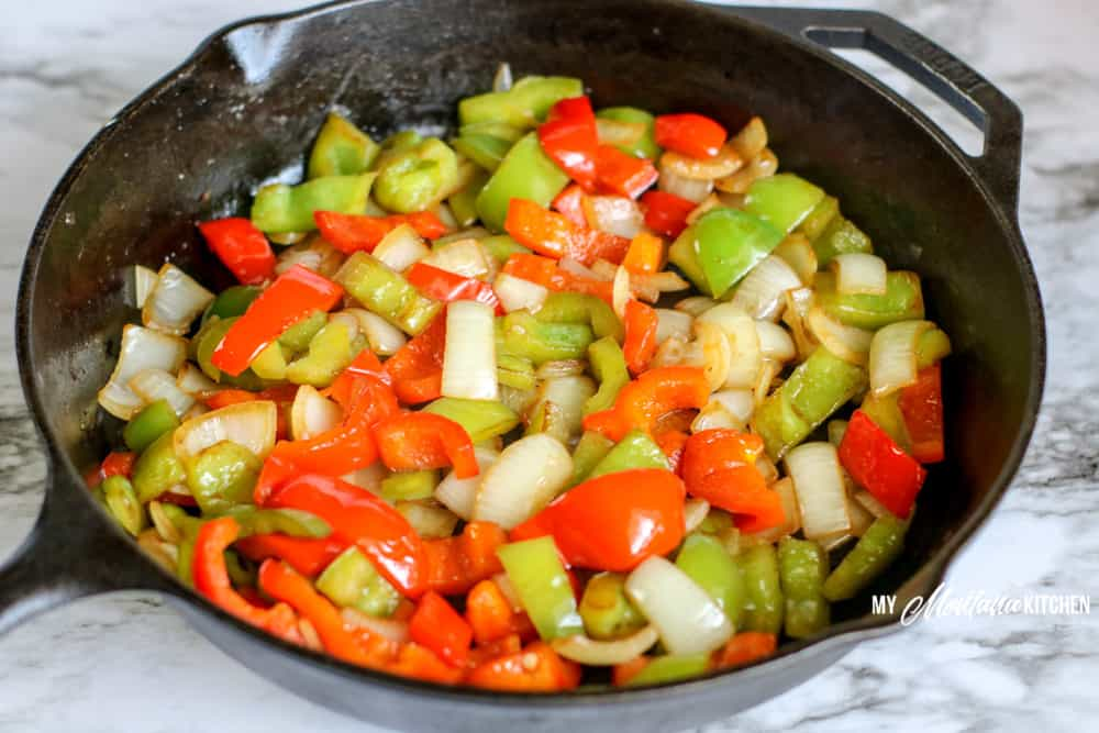 sauteed red and green peppers in cast iron skillet