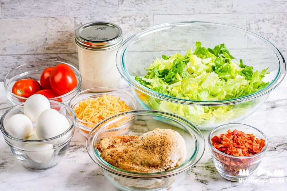 cobb salad ingredients in bowls