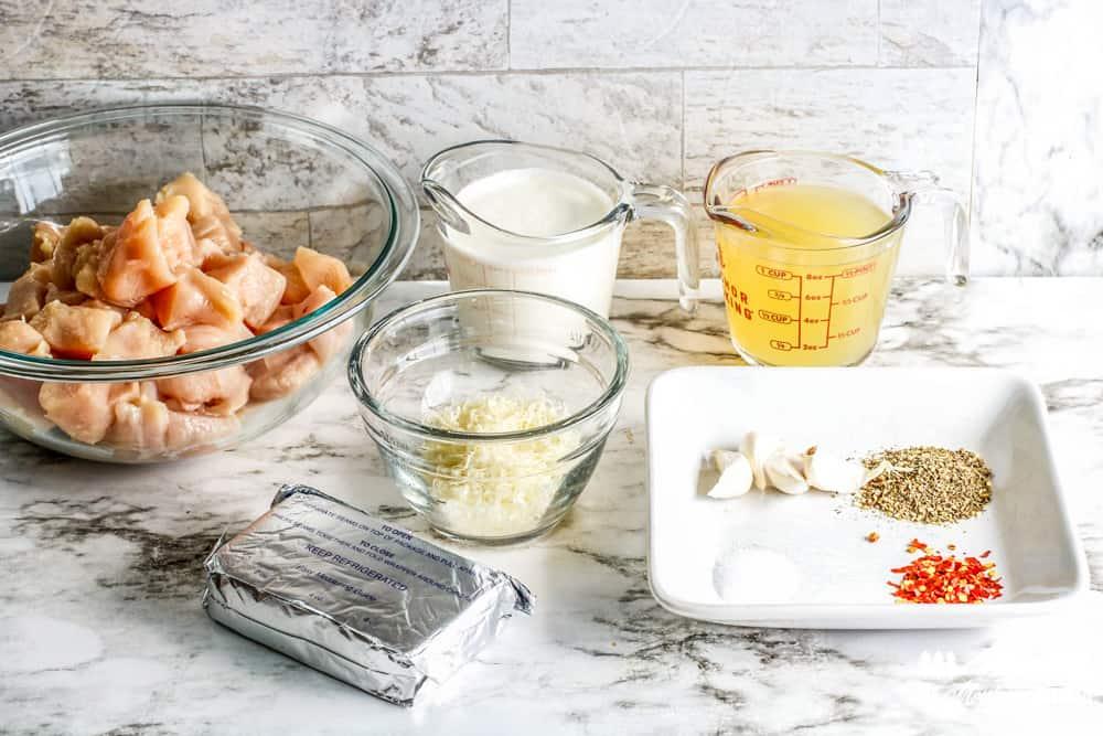 ingredients for garlic alfredo chicken on counter