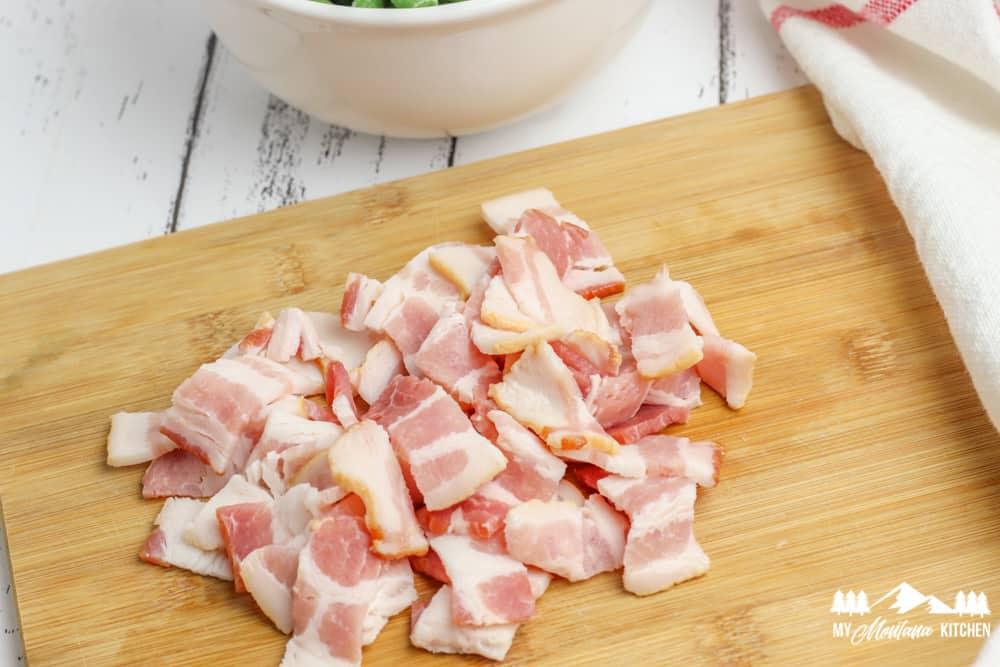 diced raw bacon on cutting board