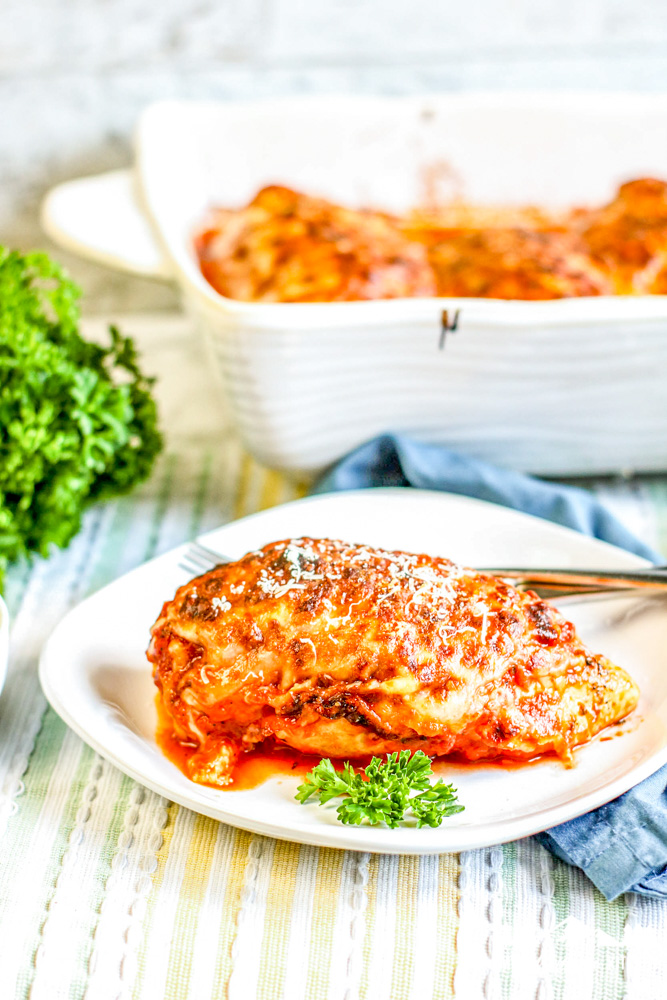 lasagna stuffed chicken breast on white plate
