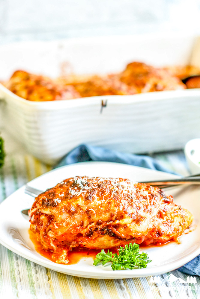 lasagna stuffed chicken on white plate