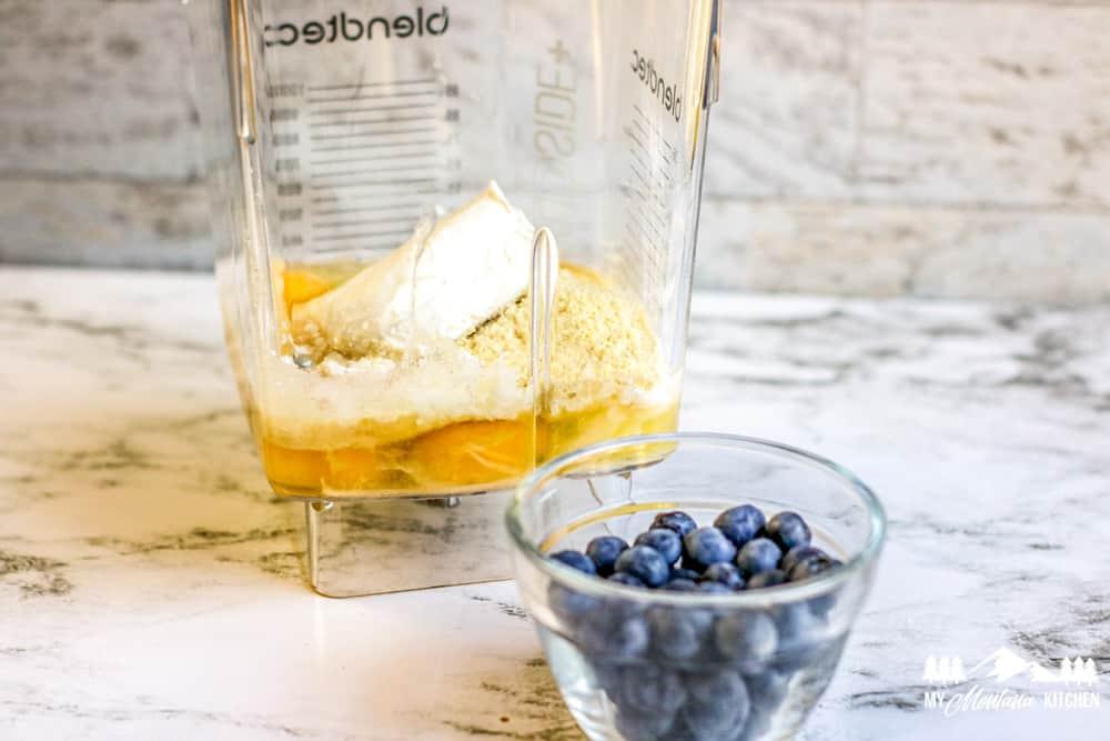 blender ingredients and fresh blueberries
