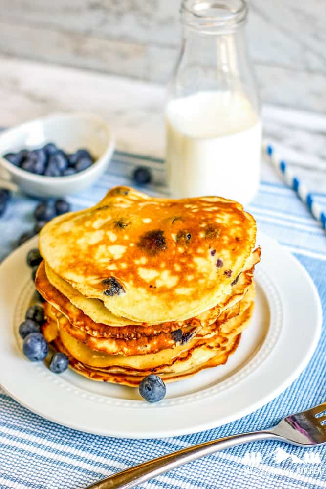 blueberry pancake stack with milk