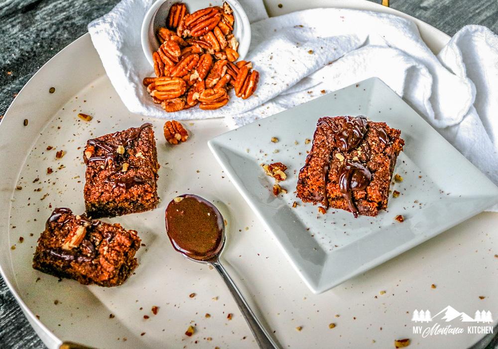 vegan pumpkin brownies on white plates