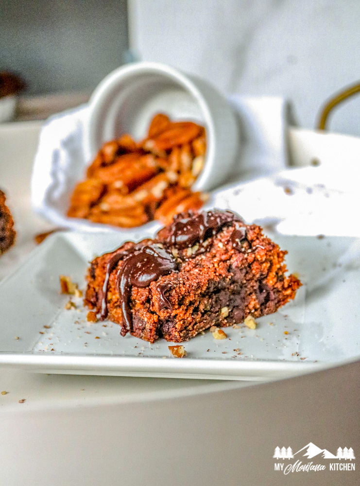 low carb pumpkin brownies on white plate with pecans