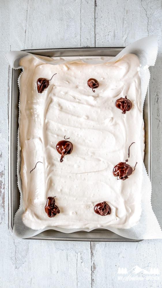 Make dollops on the yogurt using melted chocolate