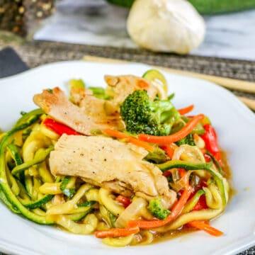 easy chicken lo mein in white dish with chopsticks